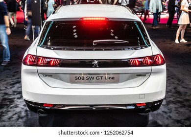 Paris, France, October 02, 2018: metallic white all new Peugeot 508 SW GT Line Station Wagon Combi at Mondial Paris Motor Show, car produced by Peugeot