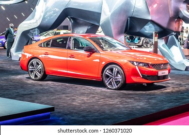 Paris, France, October 02, 2018: metallic red new Peugeot 508 GT at Mondial Paris Motor Show- car produced by Peugeot - French car manufacturer, part of Groupe PSA