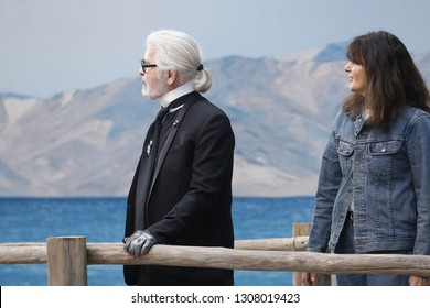 PARIS, FRANCE - OCTOBER 02: Karl Lagerfeld and Virginie Viard walks the runway after the Chanel show as part of the Paris Fashion Week Womenswear Spring/Summer 2019 on October 2, 2018 in Paris, France