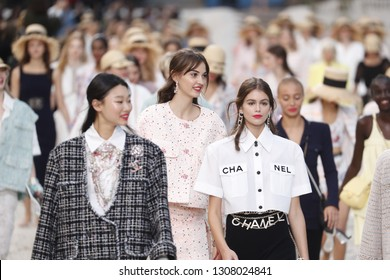 PARIS, FRANCE - OCTOBER 02: Models walk the runway finale during the Chanel show as part of the Paris Fashion Week Womenswear Spring/Summer 2019 on October 2, 2018 in Paris, France.