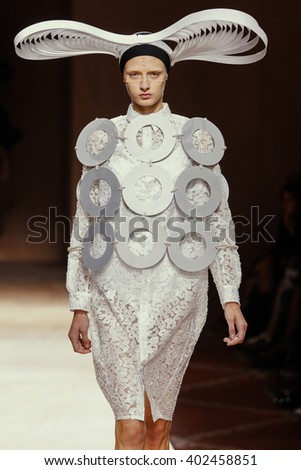 PARIS, FRANCE - OCTOBER 03: A model walks the runway during the Junya Watanabe show as part of the Paris Fashion Week Womenswear Spring/Summer 2016 on October 03, 2015 in Paris, France.
