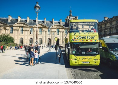 """PARIS, FRANCE - OCTOBER 05, 2016: Tourists bus """"L Open Tour"""" in the heart of Paris"""