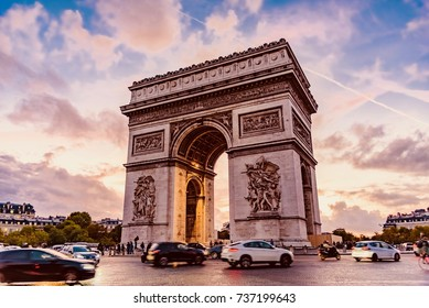 PARIS, FRANCE - OCTOBER 05, 2017 - Sunset with the Arc de Triomphe an important monument in Paris. It is located at the beginning of the famous Boulevard of the Champs-Élysées