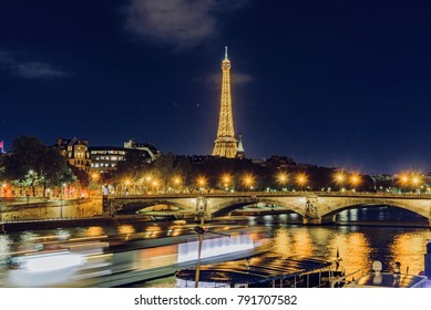 Paris, France - October 05 2017: view of the city of Paris at night with city lights lit on the river Se...