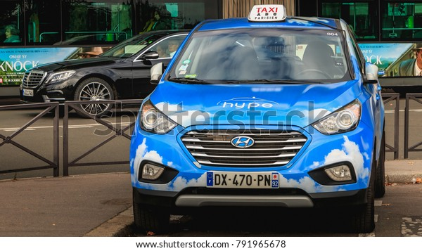 PARIS, FRANCE - October 07, 2017 : Parisian Taxi Hype from the company Taxi Electrique Parisien, the first fleet of hydrogen taxis launched in the world on the occasion of the COP 21 December 7, 2015