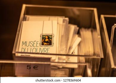 Paris, France, October 07, 2018: Louvre Museum, souvenirs for sale, postcards and other tourist loot of world's most known and famous painting Mona Lisa La Gioconda Leonardo da Vinci