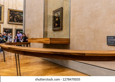 Paris, France, October 07, 2018: Louvre Museum, tourists using cameras, mobile phones over heads, taking pictures of world's most known and famous painting Mona Lisa La Gioconda Leonardo da Vinci