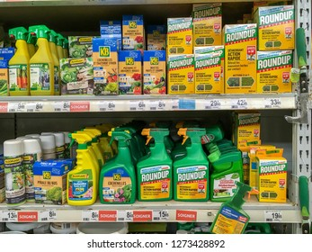 Paris, France - October 08, 2018 : Shelves with a variety of Herbicides in a french Hypermarket. Roundup is a brand-name of an herbicide containing glyphosate, made by Monsanto Company.