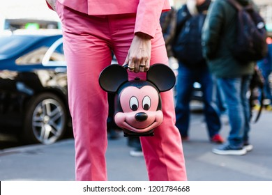 PARIS, FRANCE - OCTOBER 1, 2018: A woman holding Mickey Mouse head bag is seen outside STELLA McCARTNEY SS'2019 show at Paris Fashion Week
