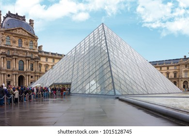 Paris, France - October 10, 2013: Many tourists from around the world visited Louvre pyramid with Louvre museum