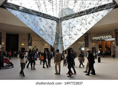 Paris, France - October 11, 2014: people walking around the inverted pyramid display underneath the Louvre museum
