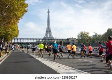 PARIS, FRANCE - OCTOBER 11, 2015: People running marathon in historical center of Paris, France