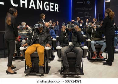 PARIS, FRANCE - OCTOBER 11, 2016: Man tries virtual reality Samsung Gear VR headset during Paris Motor Show.