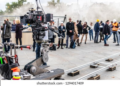 Paris, France, October 11, 2018: film set for the film production, publicly available place near Notre-Dame Cathedral, director, operator, camera on the trolley cart, artificial fog, actors