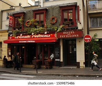 Paris, France - October 13, 2014: street scene in front of seafood restaurant and city hotel with colorful facade.