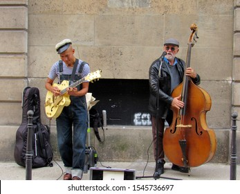 Paris France - October 13, 2019. Two jazz musicians performing on the street in the Marais section of paris.