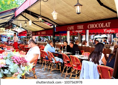 PARIS, FRANCE - OCTOBER 13th, 2017 : tourists having lunch in the classic parisian cafe at Place du Tertre in Monmartre, Paris, France