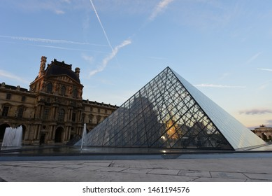 Paris, France - October 14, 2018: View of famous Louvre Museum with Louvre Pyramid at sunrise. Louvre Museum is one of the largest and most visited museums worldwide