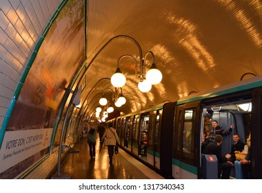 PARIS  FRANCE OCTOBER 15, 2014:  Classic Metro interior for the Metropolitain underground railway system. The metro transports annually millions of inhabitants and tourists.