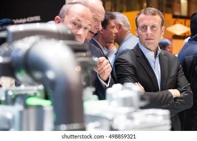 PARIS, FRANCE - OCTOBER 15, 2016 : Emmanuel Macron in front of a Renault ZOE engine at the Paris Motor Show 2016.