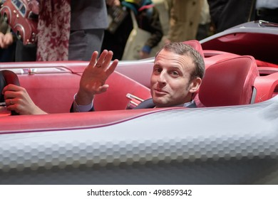 PARIS, FRANCE - OCTOBER 15, 2016 : Emmanuel Macron inside the concept car Trezor from Car manufacturer Renault (Renault Nissan group) at the Paris Motor Show 2016.