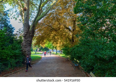 Paris, France - October 15, 2016: unidentified people are jogging in the Park Buttes-Chaumont. It is the 5th larges park in Paris, opened 1867