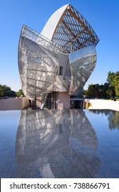 PARIS, FRANCE, October 15, 2017 -  (Louis Vuitton Foundation) museum by Frank Gehry. Front view of Fondation Louis Vuitton with reflection in pool on October 15 in Paris, France