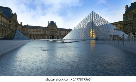Paris, France - October 15, 2018: View of famous Louvre Museum with Louvre Pyramid in sunny day. Louvre Museum is one of the largest and most visited museums worldwide