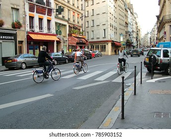 Paris, France - October 16, 2005: Cyclists on one of the central streets.  A typical urban scene.
