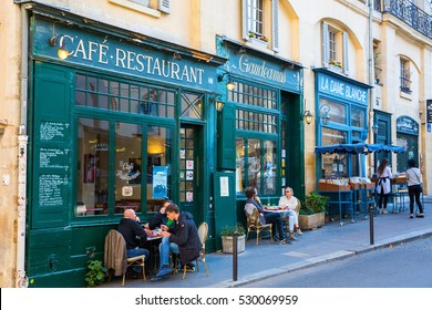 Paris, France - October 16, 2016: old cafes in the Quartier Latin with unidentified people. Quartier Latin is the traditional student area known for its student life, lively atmosphere and bistros