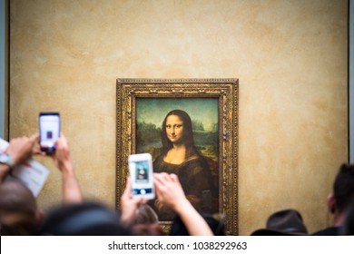PARIS, FRANCE - OCTOBER 16, 2017: Louvre Museum Visitors Taking Pictures of Leonardo da Vinci's Mona Lisa Painting with their Smartphones.