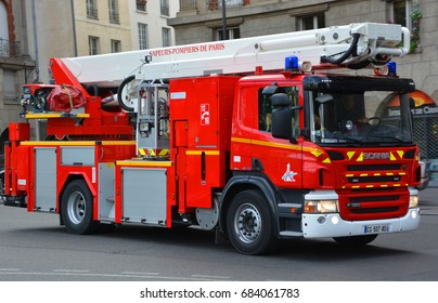 PARIS, FRANCE OCTOBER 16: Fire Truck on the street of Paris downtown on october 16, 2014. The Paris Fire Brigade , is a French Army unit which serves as the fire service for Paris.