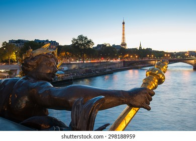 Paris, France. October 18. 2014. View from the famous Alexandre 3 Bridge to the illuminated Eiffel Tower at night. HDR Look.