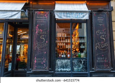 Paris, France - October 18, 2016: historical cafe on the Ile Saint Louis with unidentified people. It is one of two natural islands in the Seine river connected to the rest of Paris by four bridges