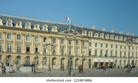 PARIS, FRANCE – OCTOBER 18, 2018: People walk past the Ministry of Justice in Place Vendome which was completed in 1702 during the reign of Louis XIV, the Sun King.