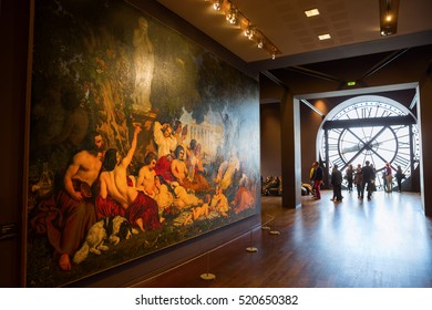 Paris, France - October 19, 2016: artwork and giant clock in the Musee dOrsay with unidentified people. The museum is a former Beaux-Arts railway station. It is one of the largest museums in Europe
