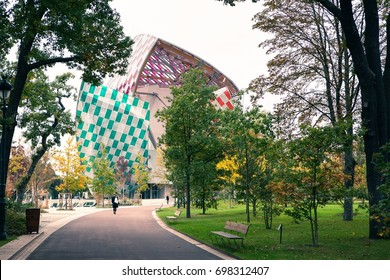 Paris, France - October 19, 2016: the Museum of modern art Foundation Louis Vuitton, view from the Park with walking people