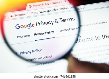 Paris, France - October 19, 2017 :   concept of Privacy terms on Google website magnified with magnifying glass