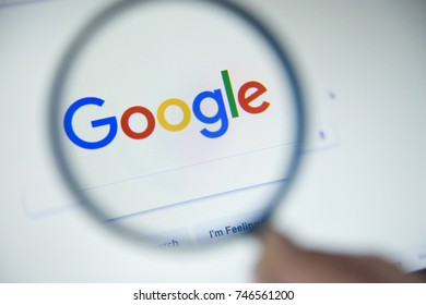 Paris, France - October 19, 2017 : Google  homepage on the screen under a magnifying glass. Google is world's most popular search engine