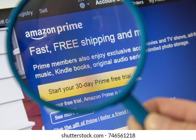 Paris, France - October 19, 2017 : Amazon Prime trial page magnified with magnifying glass.