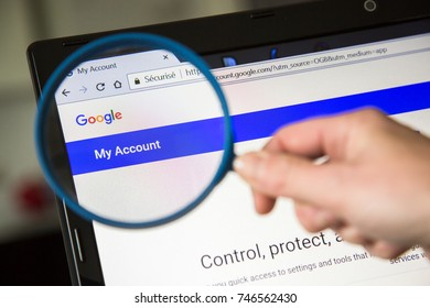 Paris, France - October 19, 2017 : icon account on Google magnified with magnifying glass