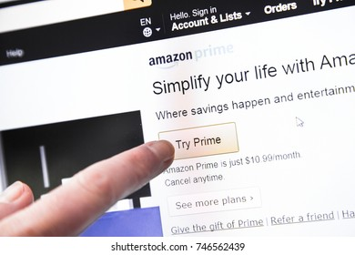 Paris, France - October 19, 2017 : Amazon Sign in page of Website with a finger touching the screen