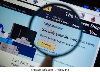 Paris, France - October 19, 2017 : Amazon Prime logo homepage magnified with magnifying glass