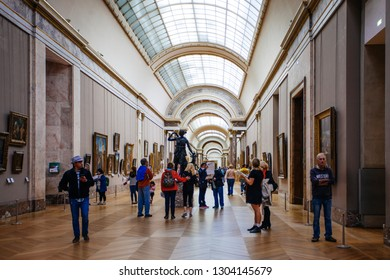 Paris, France - October 2, 2016: Tourists visit art gallery in the Louvre Museum. The Louvre Museum is one of the largest and most visited museums worldwide