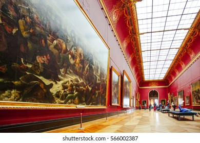 PARIS, FRANCE - OCTOBER 2, 2016: Tourists visit art gallery in Louvre Museum. Louvre Museum is one of the largest and most visited museums worldwide.