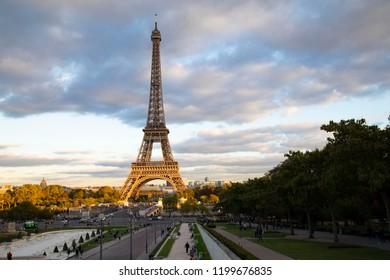 Paris, France- October 2, 2018: The setting sun partially illuminates the Eiffel tower.