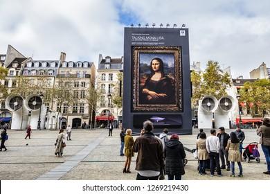 "PARIS, FRANCE - OCTOBER 2, 2018: Huge outdoor exhibit: Mona Lisa on square in front of Centre Georges Pompidou. Campaign was part of BMW Group program for Paris Motor Show ""Mondial de Automobile 2018"""