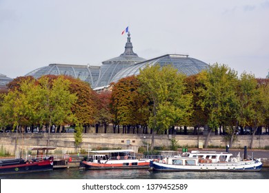 PARIS, FRANCE OCTOBER 20:  Boat house along Seine river on october 20 2014 in Paris France.  In all there are about 1,000 houseboats in Paris, their postal addresses are written on the boats!