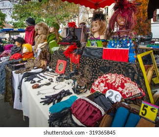 PARIS, FRANCE - OCTOBER 23, 2014: Colorful used clothing for women is for sale at a flea market in Place d' Aligre.