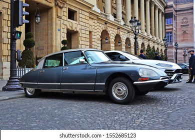 Paris, France - October 24th 2019 : Grey DS citroen parked in front of the Automobile club of France. You can also see a white Lamborghini Urus.